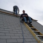 Brad laying in some shingles. Me waiting to hand him the next couple of shingles.